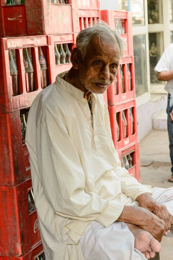 A old man resting in front of his shop