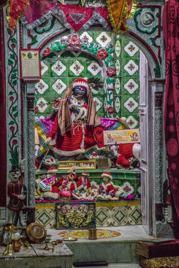 An idol of Lord Krishna dressed like Santa Claus