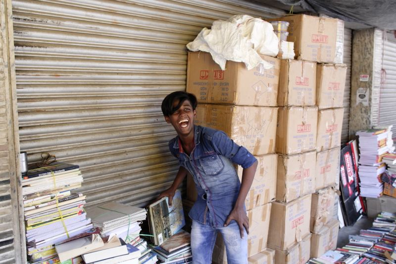 A young man selling second hand books in the weekly market